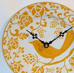 DIY clock using Pier 1 Yellow Bird Plate