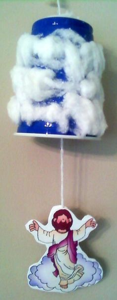 Have used this idea with a cardboard cloud...never thought of using a cup. Jesus' ascension.