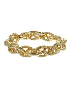 Deck your wrists with some arm candy! This bracelet is a large textured gold chain link bracelet with a lobster clasp closure. It can be worn alone, or stacked. Make a statement or complete an outfit! The Glitter Vault