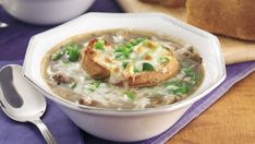 Slices of fresh-baked Pillsbury® crusty French loaf top a beefy onion soup in a classic twist for two.