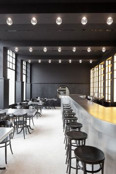 black wall and ceiling, Volkshaus Basel Bar and Brasserie by Herzog & de Meuron