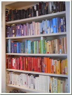 bookshelves arranged by color