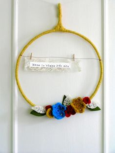 home is where you are - yarn wreath in mustard, red, turquoise, and ivory by annalea hart, via Flickr