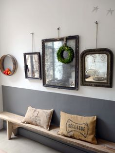 I find myself liking this..for entry way..1/3 of wall in a color of paint and second color, wood bench, burlap french pillows..mirror gallery wall!