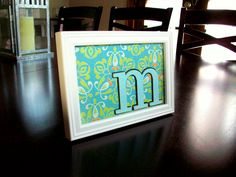 DIY Framed Initial (scrapbook paper + chipboard letter + black marker + cheap picture frame = great gift for co-workers that costs less than 3.00!)