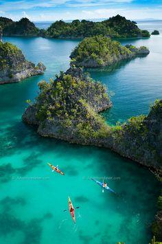 Kayaking in Raja Ampat Archipelago, West Papua, Indonesia.