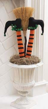 Witch legs & a broom stick in your planters by the front door for Halloween.  LOVE!!!!