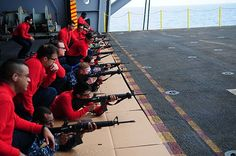 (May 5, 2013) Sailors fire M-16 A3 service rifles on an aircraft elevator aboard the aircraft carrier USS Ronald Reagan (CVN 76). Ronald Reagan is underway conducting flight deck certifications and carrier qualifications. (U.S. Navy photo by Mass Communication Specialist 3rd Class Kristina D. Walton/Released)