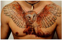 Colorful owl chest tattoo by DMITRIY SAMOHIN