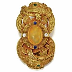 18k gold, fire opal, diamond, sapphire and emerald Celtic belt buckle ~ by T.B. Star ~1900. auction, celtic art, fire opal, emerald, belt buckles, diamond, circa 1900, art nouveau, belts