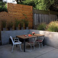 slatted wood fence. concrete and wood