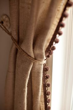 love the fringe on these burlap curtains