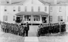 c.1910 Native children at Cantonment Oklahoma.  Assimilation: The removal of Native children from their homes, often forcibly, to attend government-funded residential boarding schools where they were severely punished for speaking their native language, pressured to adopt the 'superior' values and behaviors of the dominant Christian society, and subjected to physical and sexual abuse by school teachers and administrators.