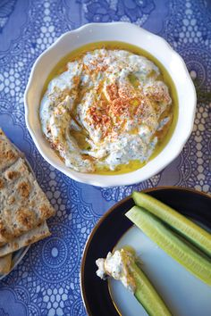 Grated cucumber marries with chopped herbs and aromatics in this iconic Greek yogurt condiment, great as a dip or served alongside meat or vegetables.