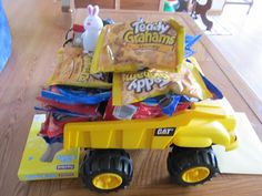 Instead of using an actual basket for Easter, use a dump truck!! My boy loved this!! actual basket, dump truck, easter basket