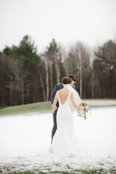 Low back lace gown. Allure. Photography: Cambria Grace Photography - www.cambriagrace.com  Read More: http://www.stylemepretty.com/2013/12/26/the-mountain-top-inn-winter-wedding/