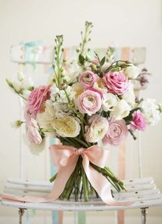 Peaceful bouquet of ranunculus, roses, stock, and lisianthus.