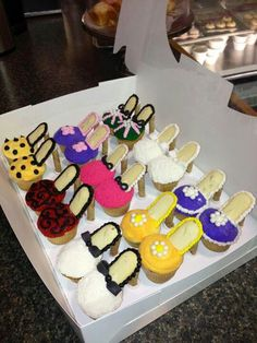 Fashionista cupcakes with Pepperidge Farm Milano cookie for the sole and a PF Pirouette wafer for the heel.