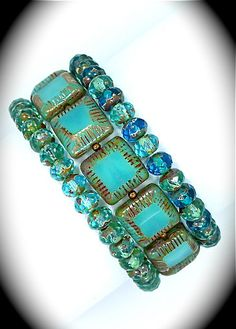 Turquoise Picasso carved beads & rondell stretch bracelets.