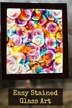 stained glass art painting on window, using wax paper and paint dabbed on and then gently spread. beautiful