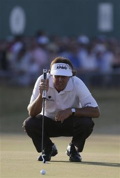 2013 Open~Phil Mickelson read the greens well enough on No. 18 to score a par-4 on Friday. (AP)