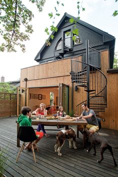 love the wood and the accordion doors and the spiral stair cases!