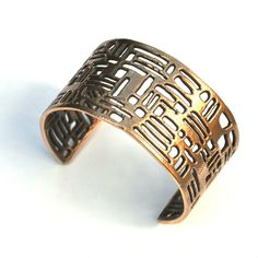 Visibly Interesting:  Solid Bronze cuff featuring architectural elements and pattern of interior and exterior spaces handcrafted by La Corza (http://www.visibleinterest.com/shop-by-category/bracelets/element-bronze-cuff/la-corza)