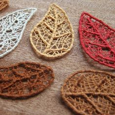 Make your own skeleton leaves with this needle lace technique - all it takes is some embroidery floss, sewing thread, and a paper template!