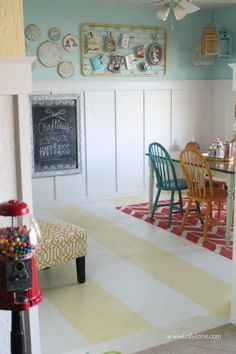 Such a fun craft room with striped painted floors!