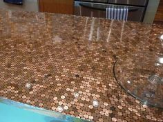table top of pennies- We refinished an end table and did the penny top. We made a few mistakes, but I LOVE it!