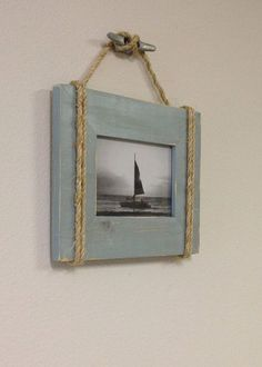 Great piece by BeachCityCreations; wooden picture frame painted blue, rope adderd with nautical knot and ships cleat as hook to hang, Beach cottage chic, coastal decor; Upcycle, Recycle, Salvage, diy, thrift, flea, repurpose, refashion!  Shared by Estate ReSale & ReDesign store:  For vintage ideas and goods shop at Estate ReSale & ReDesign, Bonita Springs, FL; http://www.etsy.com/listing/157739180/shabby-chic-nautical-beach-cottage-5x7