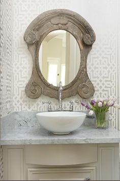 gray and white wallpaper + vintage style wood mirror