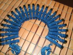 This Zipper has 25 blue painted clips with hand painted black tips. Blue beads on a 9 foot blue cord . Finger loops at each end ( for easy Zip Action) finish off this beauty. Use the 7 foot leather cord creatively ...then pull them off slowly...or just Zip them Off:-)