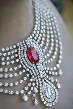 Detail of the 15.29-carat intense red ruby from Africa set in a necklace from Cartier, at the 27th Biennale des Antiquaires