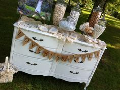 love the idea of the candy bar on a antique white dresser...