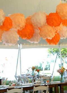 Fun poof dyi decorations for this outdoor Door County wedding.