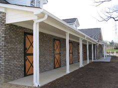 Stone walls with wood dutch doors - dream stable