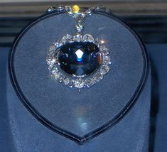 The Hope Diamond! Museum of Natural History, Washington D.C.    The weight of the Hope diamond for many years was reported to be 44.5 carats. In 1974 it was removed from its setting and found actually to weigh 45.52 carats. It is classified as a type IIb diamond, which are semiconductive and usually phosphoresce. The Hope diamond phosphoresces a strong red color, which will last for several seconds after exposure to short wave ultra-violet light. The diamond's blue coloration is attributed to...