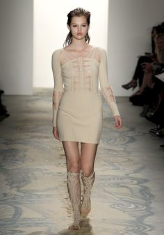 Jen Kao: Spring Summer 2011. Skeletal Dress, ribbed knit, features crocheted panels at the front, back, and sleeves.  http://3.bp.blogspot.com/-Ie13uD6hzbo/Th1kdZyHQcI/AAAAAAAAcdM/e_xFD8cueNc/s1600/jenka2002110943_p5_1-1.jpg     Back:  http://4.bp.blogspot.com/-UjS1LWgLLVw/Th1kp0PlkPI/AAAAAAAAceU/UHmpHGIob6s/s1600/jenka2002110943_p2_1-0.jpg