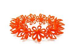 Orange flower bangle in 3D printed nylon plastic