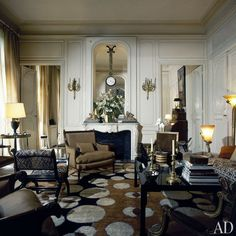 Art Deco pieces—two Edgar Brandt snake lamps and a rug designed by René Crevel—harmonize with Mme Rochas's neoclassical furnishings in the grand salon. Her interest in the Empire period was sparked by decorator Georges Geoffroy, a friend of her late husband, Marcel Rochas. Early in their marriage, M. and Mme Rochas acquired the marble and bronze gueridon, which had belonged to the Murat family.