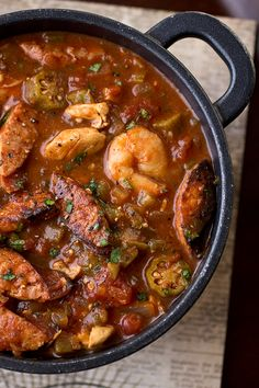 """Gumbo-laya"" , a cozy stew with spicy sausage, chicken and shrimp. Use cauliflower rice for Paleo."
