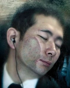 """Photographer Michael Wolf spent 30 days in a Tokyo metro station, capturing the traumatized faces of commuters on their way to work. Their woeful expressions have been immortalized in Wolf's photographic series, """"Tokyo Compression""""."""