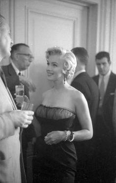 Marilyn Monroe, 1954. Is that John Huston to the left?