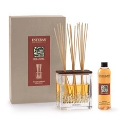 """Esteban Paris Teck & Tonka Scented Bouquet - A soft, spicy-woody fragrance. Each gift box includes a vase, its deco filler, a ceramic cap, 20 perfume sticks (8.5""""h) and a scented bouquet refill. 250ml/8.45 fl oz."""