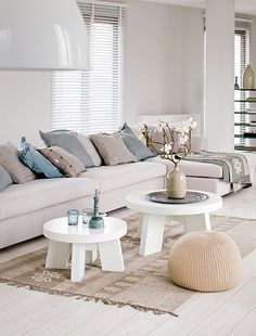 #vtwonen Living room- cream and taupe back ground pallet with feature colours for accents. Shallow Boxed fixed seating within bay window
