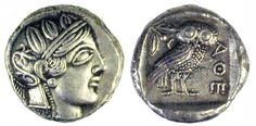 Ancient Greek silver tetradrachm coin with Athena, the Goddess of wisdom on one side, an owl with inscriptions on the other. 400 BC