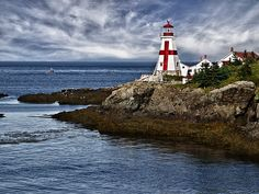"East Quaddy Headlight by Kathy Weaver  The East Quoddy lighthouse or the ""Head Harbour Lighthouse"" stands on the eastern tip of Campobello Island, New Brunswick, Canada."