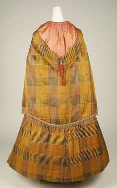 Back view of plaid silk and cotton cloak, American, mid 19th c. The silk lined hood is shown with tassels. MET