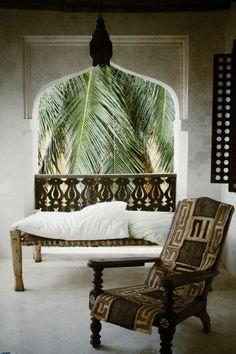 Breezy African living area on Lamu Island - Kuba cloth on chair